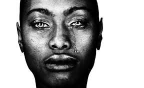 face of a Black woman with a tear down the left side of her face